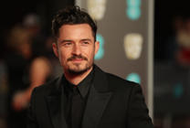 British actor Orlando Bloom poses on the red carpet upon arrival at the BAFTA British Academy Film Awards at the Royal Albert Hall in London on February 18, 2018. / AFP PHOTO / Daniel LEAL-OLIVAS        (Photo credit should read DANIEL LEAL-OLIVAS/AFP/Getty Images)