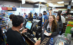 People wait in line to purchase their lottery tickets at the Blue Bird Liquor store in Hawthorne, California on October 23, 2018 ahead of the drawing tonight for the Mega Millions jackpot, now reaching USD 1.6 billion. (Photo by Frederic J. BROWN / AFP)        (Photo credit should read FREDERIC J. BROWN/AFP/Getty Images)