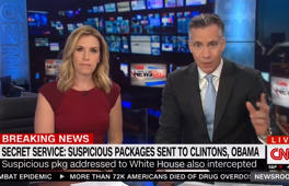 CNN anchors Poppy Harlow and Jim Sciutto moments before they are forced to evacuate the building during a live broadcast .