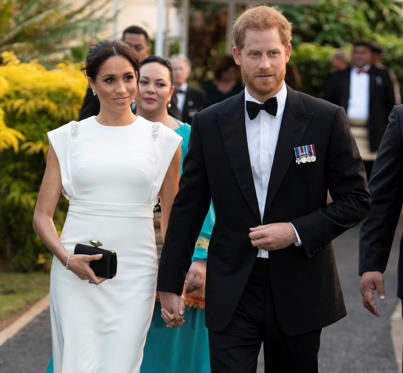 Slide 3 of 85: Meghan, Duchess of Sussex and Prince Harry, Duke of Sussex arrive to attend a state dinner in Nuku'alofa, Tonga, October 25, 2018. Paul Edwards/Pool via REUTERS