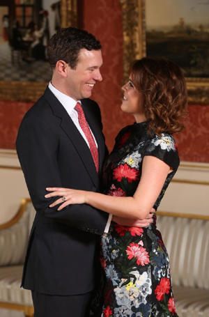 Princess Eugenie's ring features a large pink padparadscha sapphire