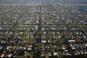In this Aug. 31, 2005 file photo, floodwaters from Hurricane Katrina surround homes in New Orleans. As the murky flood waters of Hurricane Katrina were slowly pumped out of New Orleans in 2005, the challenges the city faced were only beginning to come into focus.