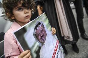 A girl holds a picture of missing journalist Jamal Khashoggi during a demonstration in front of the Saudi Arabian consulate on October 8, 2018 in Istanbul. - Jamal Khashoggi, a veteran Saudi journalist who has been critical towards the Saudi government has gone missing after visiting the kingdom's consulate in Istanbul on October 2, 2018, the Washington Post reported. Turkey has sought permission to search Saudi Arabia's consulate in Istanbul after a prominent journalist from the kingdom went missing last week following a visit to the building, Turkish television reported on October 8.