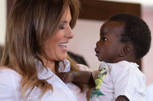 TOPSHOT - US First Lady Melania Trump (L) holds a baby as she visits the Nest Childrens Home Orphanage in Nairobi, on October 5, 2018, which primarily cares for children whose parents have been incarcerated. (Photo by SAUL LOEB / AFP)        (Photo credit should read SAUL LOEB/AFP/Getty Images)