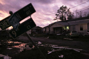 Mandatory Credit: Photo by DAN ANDERSON/EPA-EFE/REX/Shutterstock (9921855n) The sun sets on a wreckage-littered street after Hurricane Michael passed over Panama City, Florida, USA, 10 October 2018. According to media reports, Hurricane Michael made landfall on the Florida panhandle as a category 4 storm, with maximum sustained winds of up to 155 mph (200 kph). One person has died in the storm, reportedly killed by a falling tree. Hurricane Michael makes landfall in Florida, Panama City, USA - 10 Oct 2018
