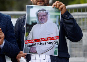 A demonstrator holds picture of Saudi journalist Jamal Khashoggi during a protest in front of Saudi Arabia's consulate in Istanbul