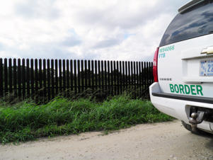 A Border Patrol vehicle is seen along the U.S. border fence in Brownsville, Texas, U.S. November 17, 2016.