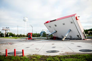 The overhang of a gas station is toppled over in the aftermath of Hurricane Michael on October 11, 2018 in Inlet Beach, Florida. - Residents of the Florida Panhandle woke to scenes of devastation Thursday after Michael tore a path through the coastal region as a powerful hurricane that killed at least two people