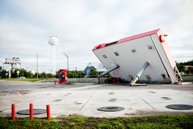 Slide 1 of 69: The overhang of a gas station is toppled over in the aftermath of Hurricane Michael on October 11, 2018 in  Inlet Beach, Florida. - Residents of the Florida Panhandle woke to scenes of devastation Thursday after Michael tore a path through the coastal region as a powerful hurricane that killed at least two people