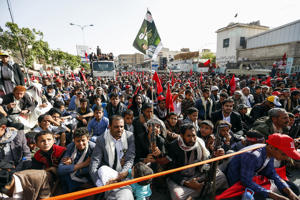 Supporters of Yemen's Shiite Huthi rebels wave flags and shout slogans as they march in Sanaa during a rally commemorating the fourth anniversary of their takeover of the capital and marking the day of Ashura, on September 20, 2018. - The day of Ashura is commemorated by Shiite Muslims worldwide and marks the climax of mourning rituals in the Islamic month of Muharram for the 7th century killing of Imam Hussein, the grandson of Prophet Mohammed, in the Battle of Karbala in 680 AD. (Photo by MOHAMMED HUWAIS / AFP)        (Photo credit should read MOHAMMED HUWAIS/AFP/Getty Images)
