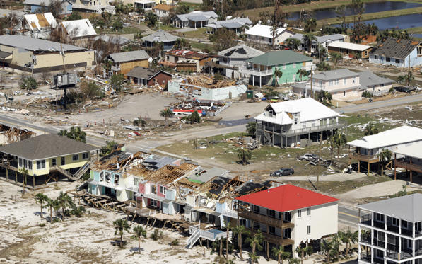 Slide 1 of 80: Homes destroyed by Hurricane Michael are shown from the air October 11, 2018 in Mexico Beach, Florida.