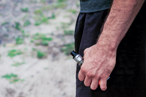 Man holding electronic cigarette