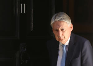 Britain's Chancellor of the Exchequer Philip Hammond leaves 11 Downing Street