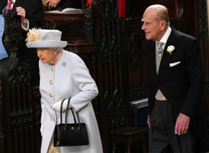 Queen Elizabeth II and the Duke of Edinburgh arrive ahead of the wedding of Princess Eugenie to Jack Brooksbank at St George's Chapel in Windsor.