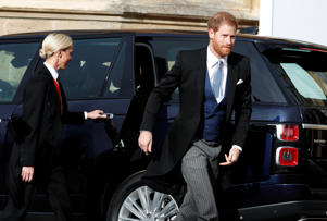 Britain's Prince Harry arrives for the wedding of Princess Eugenie of York and Jack Brooksbank at St George's Chapel, Windsor Castle.