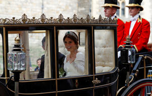 Britain's Princess Eugenie and Jack Brooksbank leave the St George's Chapel after their wedding at Windsor Castle.
