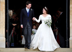 Britain's Princess Eugenie and Jack Brooksbank leave the St George's Chapel after their wedding at Windsor Castle, Windsor.