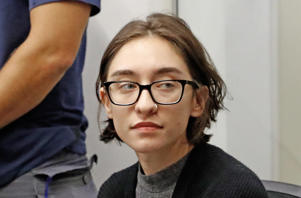 US student Lara Alqasem sits for a hearing at the Tel Aviv district Court on October 11, 2018. - The student was refused entry for alleged support of a pro-Palestinian boycott of goods from Israel has chosen to stay and fight the ban in court. Immigration authority spokeswoman Sabine Haddad told AFP that Lara was being held at an immigration facility but was not under arrest. (Photo by JACK GUEZ / AFP)        (Photo credit should read JACK GUEZ/AFP/Getty Images)