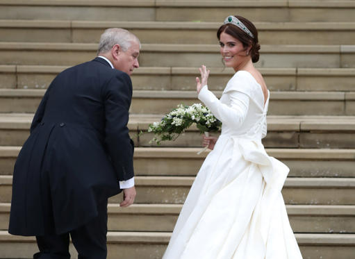 Princess Eugenie arrives with her father, the Duke of York, for her wedding  to Jack Brooksbank at St George's Chapel in Windsor Castle, Britain October 12, 2018. Steve Parsons/Pool via REUTERS