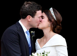 Britain's Princess Eugenie and Jack Brooksbank kiss as they leave after their wedding at St George's Chapel in Windsor Castle.