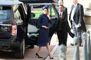 The Duchess of Sussex arrives for the wedding of Princess Eugenie to Jack Brooksbank at St George's Chapel in Windsor.