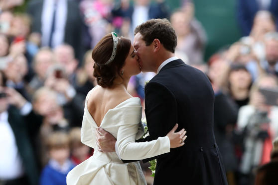 Princess Eugenie and her new husband Jack Brooksbank kiss as they leave St George's Chapel in Windsor Castle, Windsor, Britain, October 12, 2018. Yui Mok/Pool via REUTERS