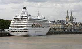The tourist cruise ship Crystal Symphony is docked, 17 August 2007 in Bordeaux, southwestern France. Many tourists visited the city of Bordeaux, as it was recently included on the prestigious list of World Heritage Sites by UNESCO. AFP PHOTO JEAN PIERRE MULLER (Photo credit should read JEAN-PIERRE MULLER/AFP/Getty Images)