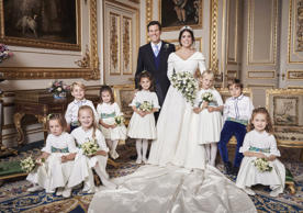 In this photo released on Saturday, Oct. 13 2018 by Buckingham Palace, Britain's Princess Eugenie of York and Jack Brooksbank are photographed in the White Drawing Room, Windsor Castle with from left, back row, Prince George, Princess Charlotte, Theodora Williams, Isla Phillips, Louis De Givenchy. Front row, Mia Tindall Savannah Phillips and Maud Windsor, following their Wedding, at St George's Chapel, Windsor Castle on Friday, Oct. 12, 2018. (Alex Bramall/Buckingham Palace via AP)