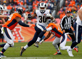 Los Angeles Rams running back Todd Gurley (30) runs against the Denver Broncos during the first half of an NFL football game, Sunday, Oct. 14, 2018, in Denver. (AP Photo/Joe Mahoney)