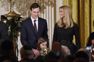 WASHINGTON, DC - DECEMBER 07: Arabella Kushner lights the menorah as Jared Kushner and Ivanka Trump look on during a Hanukkah Reception in the East Room of the White House on December 7, 2017 in Washington, DC.  (Photo by Olivier Douliery/Getty Images)