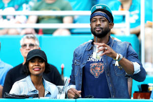 MIAMI, FL - OCTOBER 14:  Dwyane Wade of the Miami Heat and wife and actress Gabrielle Union attend the game between the Miami Dolphins and Chicago Bears at Hard Rock Stadium on October 14, 2018 in Miami, Florida.  (Photo by Marc Serota/Getty Images)