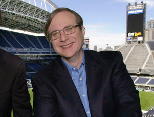FILE - In this July 17, 2001 file photo, Seattle Seahawks owner Paul Allen appears in a suite in the team's stadium in Seattle. Allen, billionaire owner of the Trail Blazers and the Seattle Seahawks and Microsoft co-founder, died Monday, Oct. 15, 2018 at age 65. Earlier this month Allen said the cancer he was treated for in 2009, non-Hodgkin's lymphoma, had returned.  (AP Photo/Elaine Thompson, File)