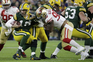 San Francisco 49ers defensive end Ronald Blair (98) sacks Green Bay Packers quarterback Aaron Rodgers (12) during the second half of an NFL football game Monday, Oct. 15, 2018, in Green Bay, Wis. The Packers won 33-30. (AP Photo/Mike Roemer)