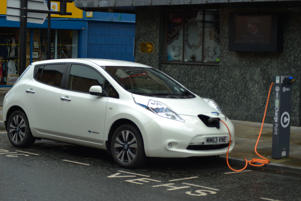 A Nissan Leaf car using an electric re-charging point