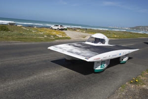 The car of the Swiss team, Solar Energy Racers drives on the 8th and the final day of the Sasol Solar Challenge, on September 29, 2018, in Cape Agulhas, the Southern-most point of Africa. - The eight-day race has South African and international solar-powered cars, vying to rack up as much distance as they can on roads and loops between Pretoria and Cape Town. (Photo by Rodger BOSCH / AFP)        (Photo credit should read RODGER BOSCH/AFP/Getty Images)