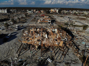 MEXICO BEACH, FL - OCTOBER 15:  Devastation left in the wake of Hurricane Michael is shown from above on October 15, 2018 in Mexico Beach, Florida. The death tolls stands at 18 blamed on Michael, which hit the Florida Panhandle as a Category 4 storm last week with sustained winds of 155 mph.   (Photo by Joe Raedle/Getty Images)