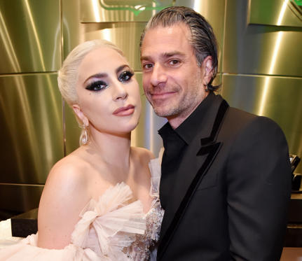 Slide 1 of 82: CAPTION: NEW YORK, NY - JANUARY 28: Recording artist Lady Gaga and agent Christian Carino embrace backstage at the 60th Annual GRAMMY Awards at Madison Square Garden on January 28, 2018 in New York City. (Photo by Kevin Mazur/Getty Images for NARAS)