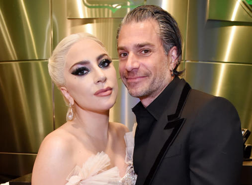 Slide 1 of 87: NEW YORK, NY - JANUARY 28: Recording artist Lady Gaga and agent Christian Carino embrace backstage at the 60th Annual GRAMMY Awards at Madison Square Garden on January 28, 2018 in New York City. (Photo by Kevin Mazur/Getty Images for NARAS)
