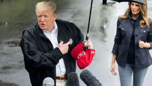 Donald Trump leaves wife Melania out in the rain while he uses an umbrella