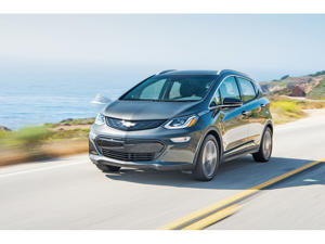 a car driving on a road: 2019 Chevrolet Bolt