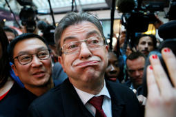 Hard Left French presidential election candidate Jean-Luc Melenchon grimaces as he arrives at his election night headquarters prior to the announcement of the first partial official results and polling agencies projections in Paris, France, Sunday, April 23, 2017. French voters are casting ballots for their next president in an unusually close first-round election Sunday, after a campaign dominated by concerns about jobs and immigration and clouded by security fears following a recent attack on police guarding the Champs-Elysees in Paris. (AP Photo/Francois Mori)
