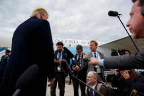 President Donald Trump listens to a question about the missing Saudi journalist Jamal Khashoggi after landing at Cincinnati Municipal Lunken Airport, Friday, Oct. 12, 2018, in Cincinnati, Ohio. (AP Photo/Evan Vucci)