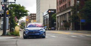Performance and Driving Impressions: The Tesla Model S is an agile sports sedan with great handling, well-controlled body motions, direct steering, and instant acceleration gratification.