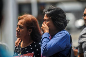 TANGERANG, INDONESIA - OCTOBER 29, 2018: Families of victims seen  at Soekarno Hatta Airport after Lion Air crash on October 29, 2018 in Tangerang, Indonesia.  A plane carrying 189 people from Jakarta to a smaller Indonesian city crashed into the Java Sea on Monday.  PHOTOGRAPH BY Riau Images / Barcroft Images (Photo credit should read  via Getty Images)