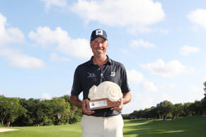 Matt Kuchar of the United States celebrates with the winner's trophy on the 18th green after the final round of the Mayakoba Golf Classic at El Camaleon Mayakoba Golf Course on November 11, 2018 in Playa del Carmen, Mexico.
