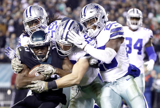 Slide 2 of 75: Philadelphia Eagles wide receiver Nelson Agholor, bottom left, is tackled by Dallas Cowboys middle linebacker Jaylon Smith, top left, outside linebacker Leighton Vander Esch, center, and free safety Xavier Woods during the second half of an NFL football game, Sunday, Nov. 11, 2018, in Philadelphia.