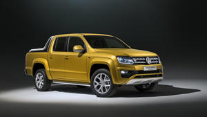 a yellow car parked on the side of a road: 2017 VW Amarok Aventura Exclusive concept