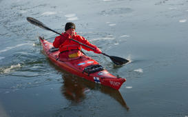 Peer Schmidt-Walther makes his way through the canal on his open-water kayak during sunny weather in Stralsund, Germany, 27 January 2017. The 71-year-old canoe speacialist practices throughout the whole year in the waters of Stralsund. Photo: Stefan Sauer/dpa-Zentralbild/dpa | usage worldwide   (Photo by Stefan Sauer/picture alliance via Getty Images)