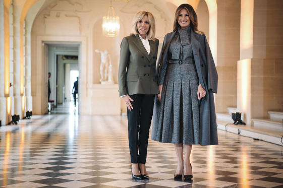Slide 2 of 176: French President's wife Brigitte Macron (L) and US First Lady Melania Trump poseduring a spousal event at the Chateau de Versailles (Palace of Versailles) in Versailles, outside Paris, on November 11, 2018 as part of commemorations marking the 100th anniversary of the 11 November 1918 armistice, ending World War I. (Photo by LUCAS BARIOULET / AFP)        (Photo credit should read LUCAS BARIOULET/AFP/Getty Images)