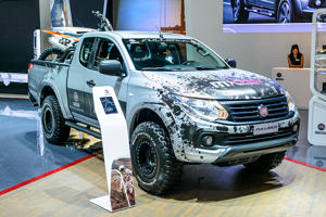 BRUSSELS, BELGIUM - JANUARY 13:      Fiat Fullback pickup truck with a motorcycle in the back on display at Brussels Expo on January 13, 2017 in Brussels, Belgium. The Fiat Fullback is also marketed as Mitsubishi L200 and is fitted with a 2.4L diesel engine with a 6-speed manual or 5-speed automatic gearbox. (Photo by Sjoerd van der Wal/Getty Images)